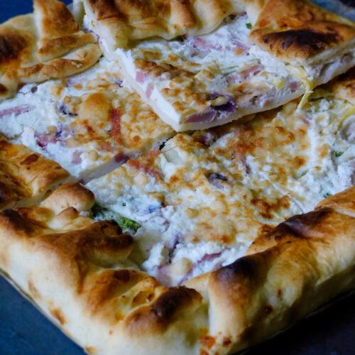Torta salata con zucchine, prosciutto e ricotta